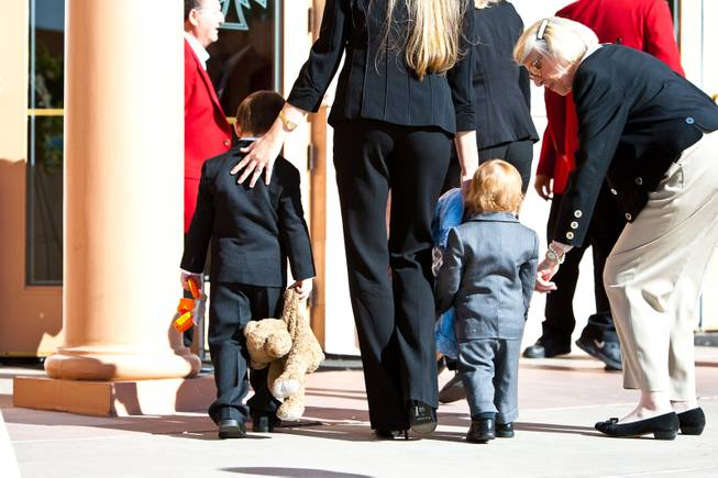 "The youngest great grandchildren of John Davis ""Jackie"" Gaughan (from left) 3-year-old Michael James Gaughan and 17-month-old Ryland Gaughan are escorted into the memorial mass for their grandfather at St. Viator Catholic Church in Las Vegas on St. Patrick's Day, March 17, 2014."