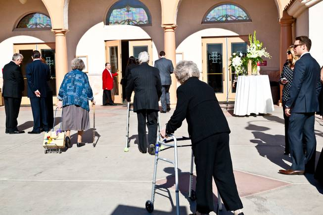 "Long-time friends and family arrive to pay their respects at the memorial mass for John Davis ""Jackie"" Gaughan held at St. Viator Catholic Church in Las Vegas on St. Patrick's Day, March 17, 2014."