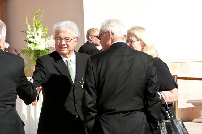 "Councilman Bob Coffin greets friends while attending the memorial mass for John Davis ""Jackie"" Gaughan held at St. Viator Catholic Church in Las Vegas on St. Patrick's Day, March 17, 2014."