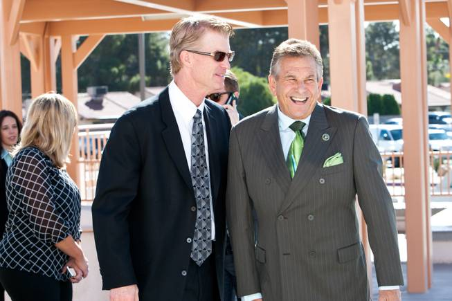 "Honoring the Irish heritage of Jackie Gaughan, Steve Schorr is seen wearing a green tie while visiting with Steve Stallworth, left, at the memorial mass for John Davis ""Jackie"" Gaughan held at St. Viator Catholic Church in Las Vegas on St. Patrick's Day, March 17, 2014."
