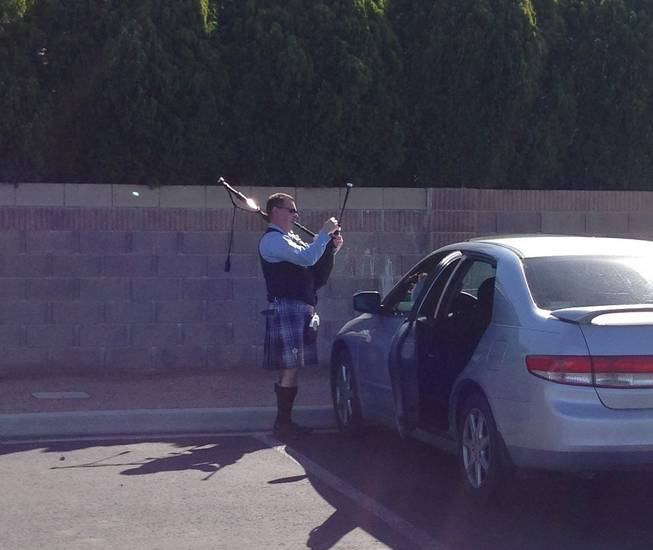 A bagpiper tunes his instrument before he plays during the funeral service of Las Vegas casino legend Jackie Gaughan at St. Viator Church on March 17, 2014.