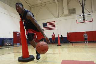 Findlay Prep guard Renathan Ona Embo takes part in a ball handling drill during practice Tuesday, March 18, 2014.