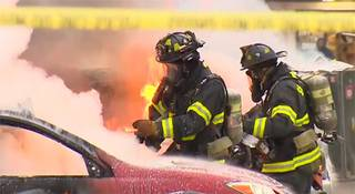 In this image made from video provided by KOMO-TV, emergency crews respond to the scene of a news helicopter crash outside the KOMO-TV studios near the space needle in Seattle, Tuesday, March 18, 2014, in Seattle.