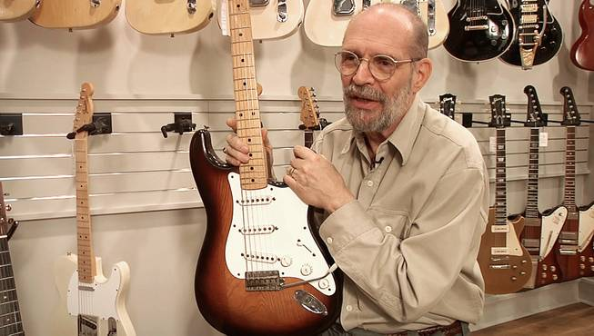 George Gruhn poses with the first production model Fender Stratocaster guitar, Tuesday, March 18, 2014, in Nashville, Tenn. The sunburst-finish Strat bears the serial number 0100. Although some Strats have lower numbers that begin with 0001, Gruhn says they actually were manufactured later in that first year of production.