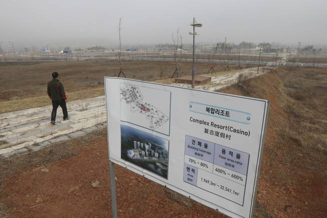 A signboard for a casino is set at its planned site in Incheon, west of Seoul, South Korea, Tuesday, March 18, 2014.