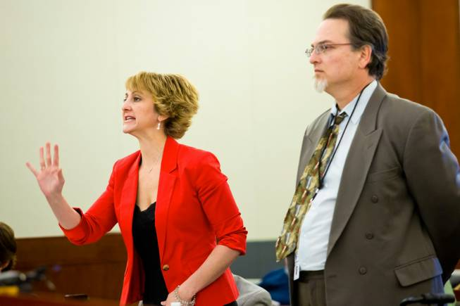 Lisa Zastrow, attorney for the Animal Foundation, and Deputy Dist. Attorney Steven Sweikart address the court during a civil hearing between Donald Thompson, co-owner of Prince and Princess Pet Shop LLC, and the Animal Foundation at the Regional Justice Center, Wednesday, March 19, 2014.