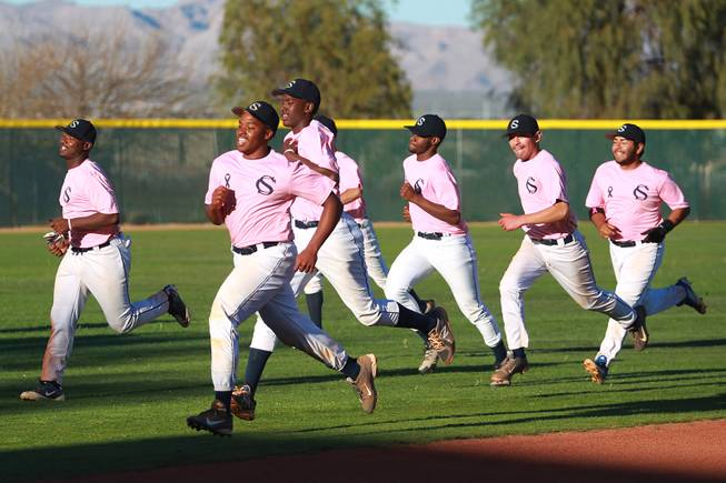 Canyon Springs players runs sprints after their game against Western Wednesday, March 19, 2014. The Pioneers wore pink jerseys for the game for cancer awareness and to honor parents of two of the players who died from cancer in the past year.