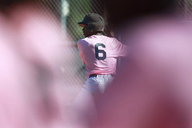 Canyon Springs hitter Rashaad Jones waits for a pitch during their game against Western Wednesday, March 19, 2014. The Pioneers wore pink jerseys for the game for cancer awareness and to honor parents of two of the players who died from cancer in the past year.