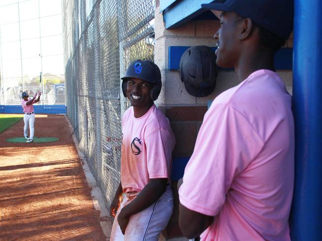 Canyon Springs players Isiah Carter and Rashaad Jones talk during their game against Western Wednesday, March 19, 2014. The Pioneers wore pink jerseys for the game for cancer awareness and to honor parents of two of the players who died from cancer in the past year.