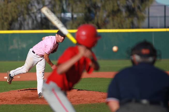 Canyon Springs pitcher Alex Molina throws to a Western player during their game  Wednesday, March 19, 2014. The Pioneers wore pink jerseys for the game for cancer awareness and to honor parents of two of the players who died from cancer in the past year.