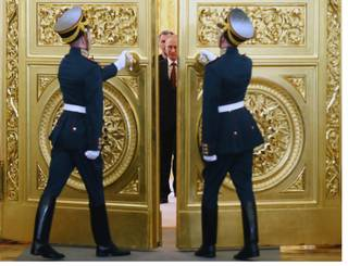Honor guards open the doors for Russian President Vladimir Putin followed by Crimean leaders entering the hall for the signing ceremony of a treaty for Crimea to join Russia,  in the Kremlin in Moscow, Tuesday, March 18, 2014.