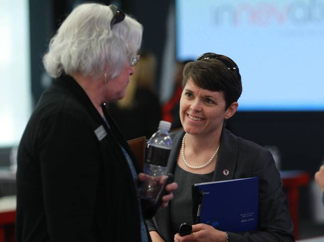 Clark County School Board members Carolyn Edwards, left, and Erin Cranor talk after a speech by Washington, D.C. schools chancellor Kaya Henderson Thursday, March 20, 2014.