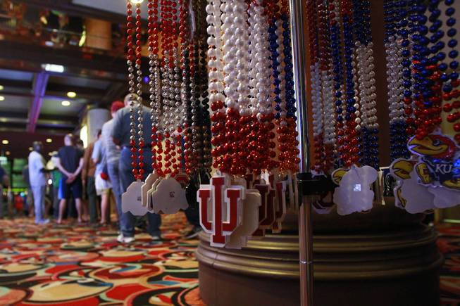 University themed necklaces for sale are positioned outside the LVH sports book during the second round of the NCAA basketball tournament Thursday, March 20, 2014.