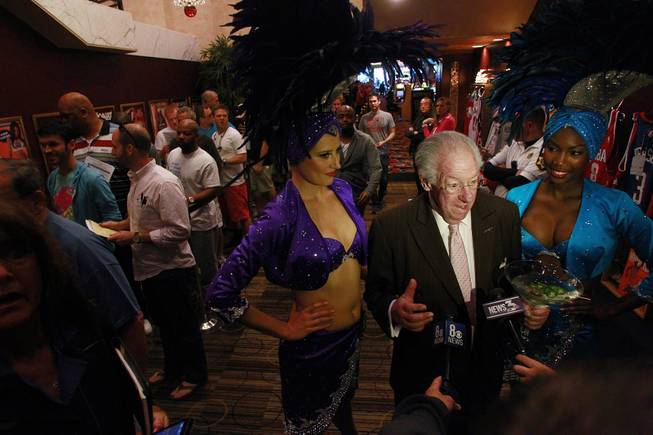 Former Las Vegas mayor Oscar Goodman talks to television reporters outside the LVH sports book during the second round of the NCAA basketball tournament Thursday, March 20, 2014.
