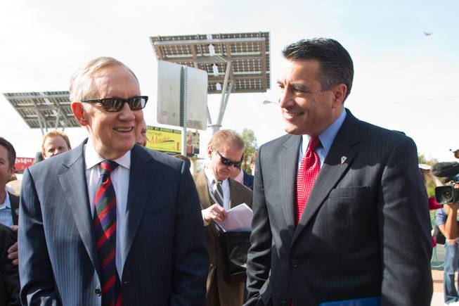 Senator Harry Reid and Governer Brian Sandoval share a laugh before meeting with the press to discuss clean energy investment in Nevada Thursday, March 20, 2014.
