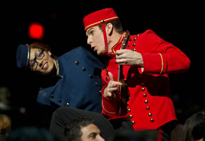 Bellhops entertain the crowd before the start of the One Night for ONE DROP dress rehearsal from the Michael Jackson ONE Theatre at Mandalay Bay on Thursday, March 20, 2014.