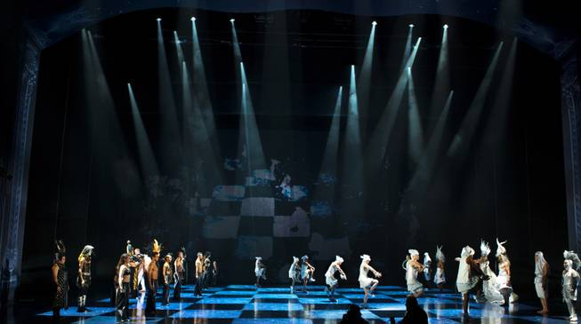 Cirque performers form a human chess board during the One Night for ONE DROP dress rehearsal in the Michael Jackson ONE Theatre on Thursday, March 20, 2014.