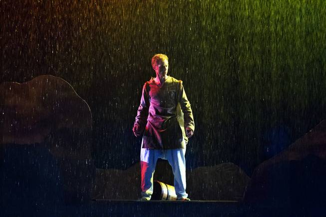 The Seeker looks down while in the rain during the One Night for ONE DROP dress rehearsal from the Michael Jackson ONE Theatre at Mandalay Bay on Thursday, March 20, 2014.