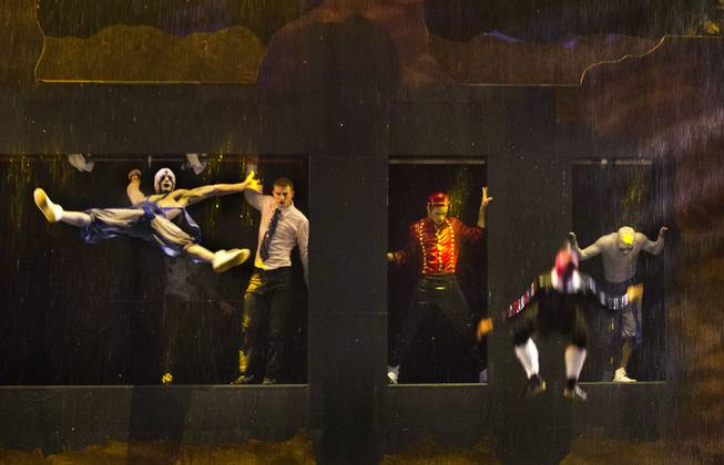 Trampoline artists leap in the rain during the One Night for ONE DROP dress rehearsal from the Michael Jackson ONE Theatre at Mandalay Bay on Thursday, March 20, 2014.