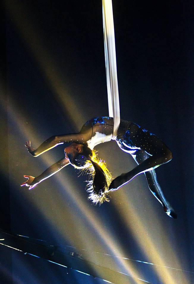 One of many aerialists performs during the One Night for ONE DROP dress rehearsal in the Michael Jackson ONE Theatre on Thursday, March 20, 2014.