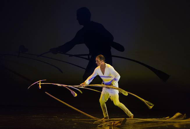 A performer balances sticks during the One Night for ONE DROP dress rehearsal in the Michael Jackson ONE Theatre on Thursday, March 20, 2014.