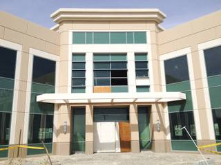 The entrance to a two-story office building on site at the mothballed medical-office project Centennial Hills Center shows signs of vandalism March 20, 2014. The center has new ownership and is slated for completion after being abandoned by collapsed lender Lehman Brothers.
