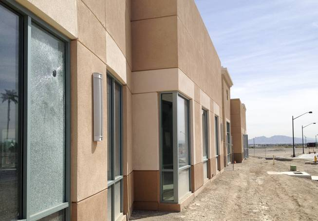 An office building onsite at the mothballed medical-office project Centennial Hills Center shows signs of vandalism March 20, 2014.  The center has new ownership and is slated for completion after being abandoned by collapsed lender Lehman Brothers.