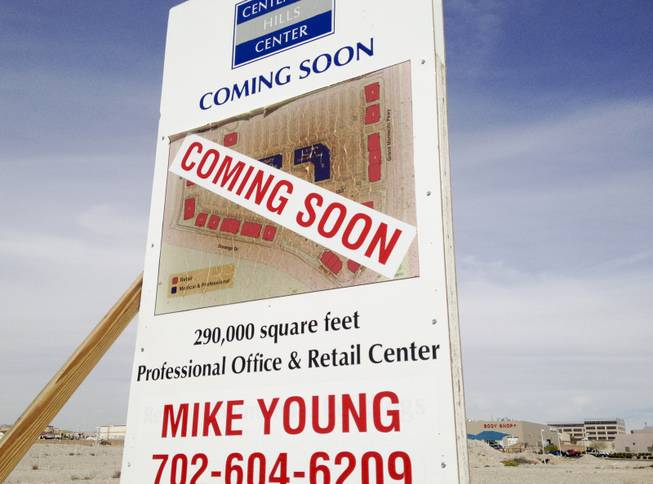A peeling and apparently sunburned sign at the project site of the Medical-office project Centennial Hills Center, which was mothballed and vandalized after lender Lehman Brothers collapsed March 20, 2014.  The center has new ownership and is slated for completion.