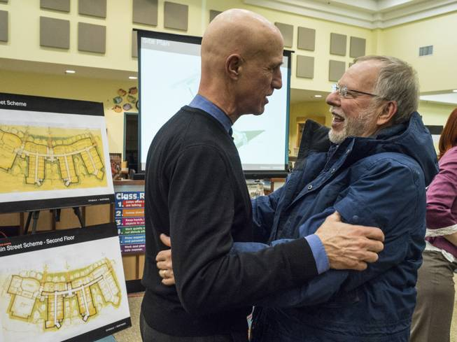Architect Barry Svigals, left, greets Gene Rosen at a meeting to introduce proposed school designs, in Newtown Conn., Feb. 11, 2014. Svigals is founder of the firm Svigals + Partners, which designed the new Sandy Hook Elementary that will replace the building, now torn down, where Adam Lanza shot and killed 20 children and six adults.