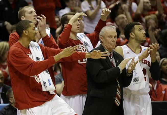 Wisconsin head coach Bo Ryan and players on the bench react after a three-pointer by Wisconsin guard Ben Brust during the second half of a second-round game in the NCAA basketball tournament Thursday, March 20, 2014, in Milwaukee.