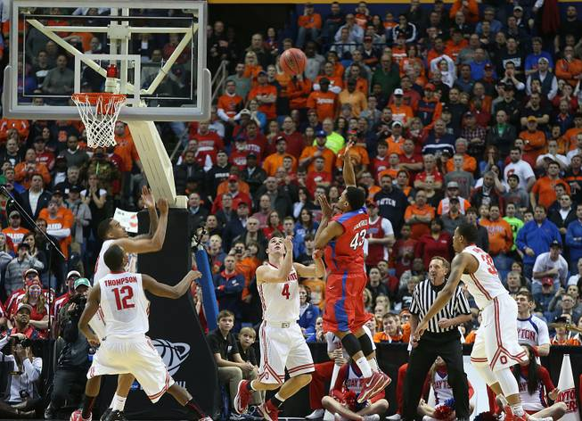 Dayton's Vee Sanford (43) hits the game-winning shot against Ohio State 3.8 seconds remaining in the second half in a second-round game of the NCAA college basketball tournament in Buffalo, N.Y., Thursday, March 20, 2014.