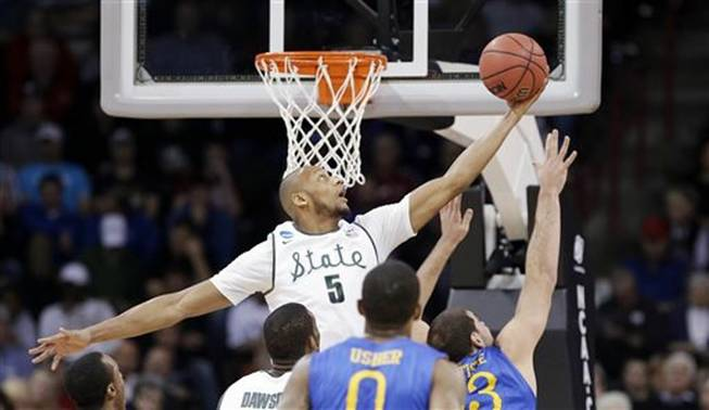 Adreian Payne (5) reaches for a loose ball against Delaware in the first half during the second round of the NCAA college basketball tournament in Spokane, Wash., Thursday, March 20, 2014.