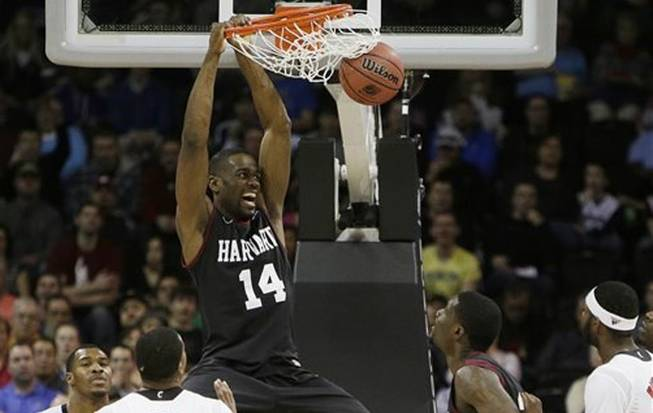 Harvard's Steve Moundou-Missi (14) dunks against Cincinnati in the second half during the second-round of the NCAA men's college basketball tournament in Spokane, Wash., on Thursday, March 20, 2014.