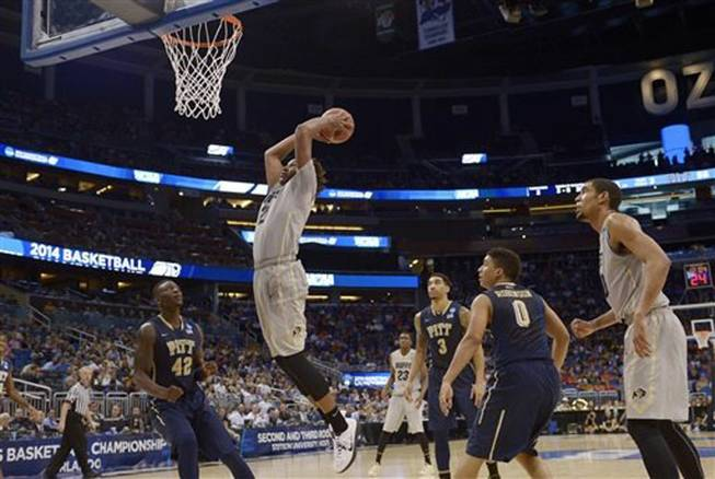 Colorado forward Xavier Johnson (2) dunks the ball during the second half in a second-round game against Pittsburgh in the NCAA college basketball tournament Thursday, March 20, 2014, in Orlando, Fla.