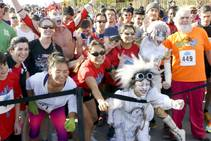 Participants pose for a photo with Cirque du Soleil performers at the Run Away with Cirque du Soleil 5K Run and One-Mile Fun Walk at the Springs Preserve on Saturday, March 15, 2014.