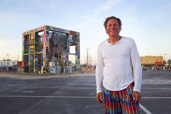 Artist Scott Cohen poses in front of his Life Cube, an interactive community art installation, in downtown Las Vegas, Friday March 21, 2014. The Life Cube, later burned, was a 24-by-24-foot plywood cube, painted by artists and filled with notes from thousands of people.