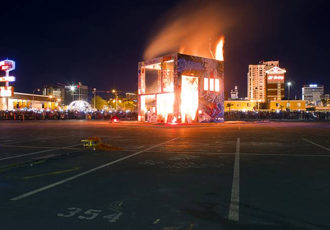 The Life Cube, an interactive community art installation, is burned in downtown Las Vegas, Friday March 21, 2014. The Life Cube, a creation of artist Scott Cohen, was a 24-by-24-foot plywood cube, painted by artists and filled with notes from thousands of people.