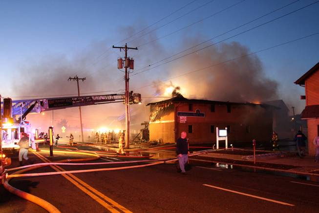 Firefighters work to put out a fire at  Mariner's Cove Inn  in Point Pleasant Beach, N.J. early Friday, March 21, 2014.