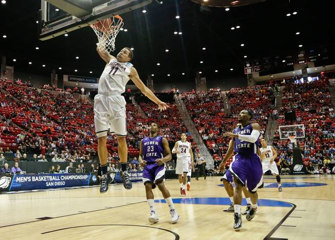 Arizona forward Aaron Gordon slams in a basket against Weber State during the first half in a second-round game in the NCAA college basketball tournament Friday, March 21, 2014, in San Diego.
