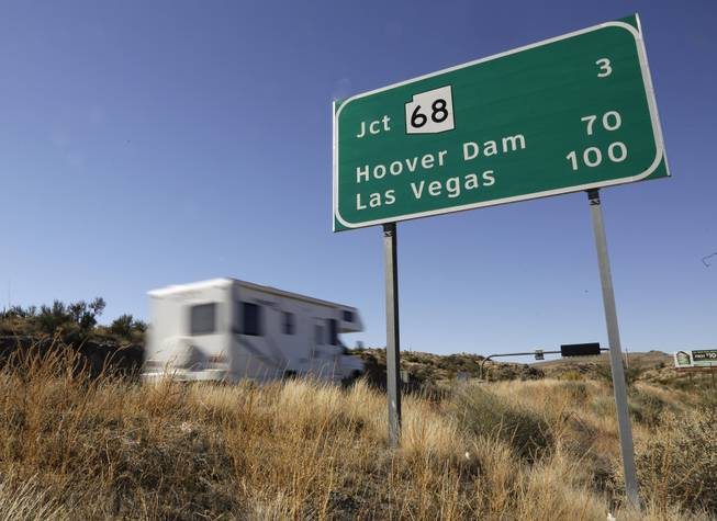 In this Friday, Nov. 8, 2013, photo, motorists head northbound on U.S. Highway 93, in Kingman, Ariz. Las Vegas and Phoenix are linked by U.S. 93, a road that narrows to two lanes and, until recently, backed up traffic over the Hoover Dam. Despite being two of the largest cities in the Southwest, they're the only major metropolitan areas in the U.S. that aren't directly connected by an interstate freeway.
