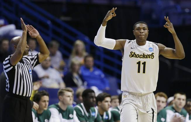 Wichita State forward Cleanthony Early (11) celebrates his three-point basket against Cal Poly during the first half of a second-round game in the NCAA college basketball tournament Friday, March 21, 2014, in St. Louis.