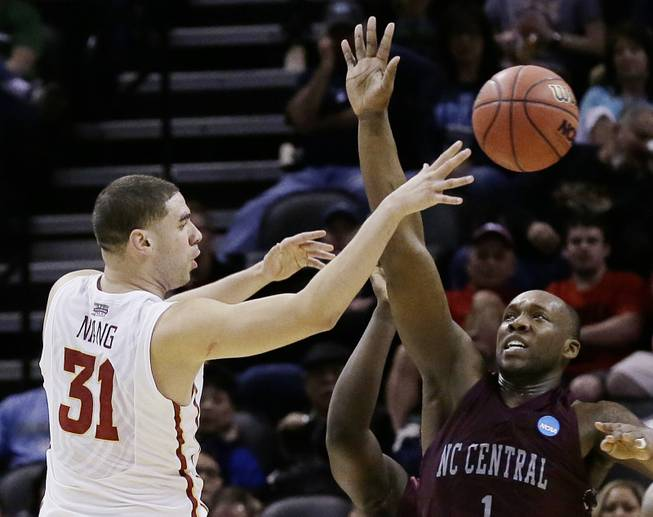Iowa State forward Georges Niang (31) pass the ball as North Carolina Central forward Jay Copeland (1) defends during the first half of a second-round game in the NCAA college basketball tournament Friday, March 21, 2014, in San Antonio.