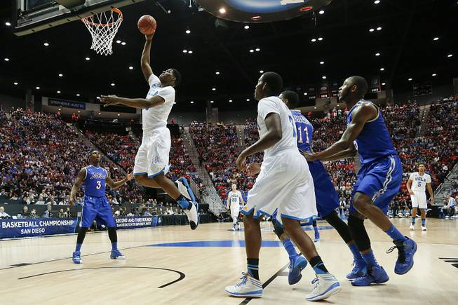 UCLA forward Tony Parker, second from left, shoots against Tulsa during the first half of a second-round game in the NCAA men's college basketball tournament Friday, March 21, 2014, in San Diego.