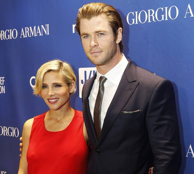 Elsa Pataky, left, and Chris Hemsworth arrive at the Sean Penn & Friends Help Haiti Home Gala at the Montage Hotel in Beverly Hills, Calif., Jan. 11, 2014. Hemsworth and his wife, Pataky, have welcomed not one, but two sons.