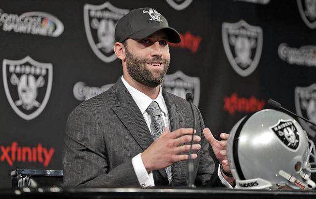 Oakland Raiders quarterback Matt Schaub gestures while speaking during a news conference Friday, March 21, 2014, at the NFL football team's practice facility in Alameda, Calif.