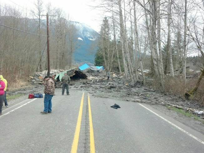 The Washington Department of Transportation says mud, trees and building materials are blocking both directions of State Route 530 near the town of Oso after a mudslide in Snohomish County on Saturday, March 22, 2014.