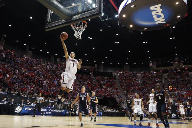 Arizona guard Gabe York scores a basket while playing Gonzaga during the first half of a third-round game in the NCAA college basketball tournament Sunday, March 23, 2014, in San Diego.