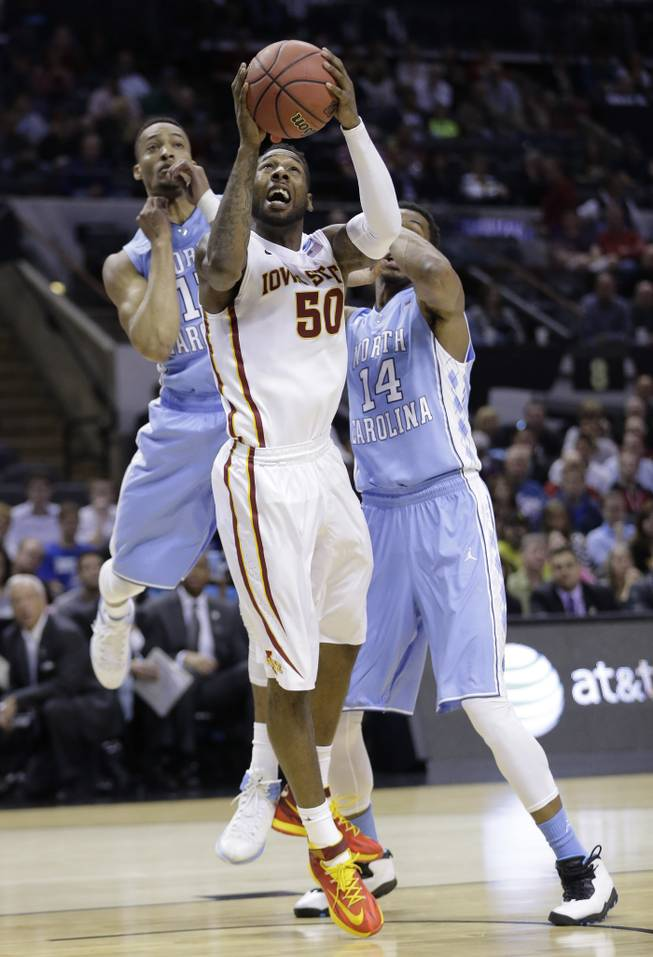 Iowa State's DeAndre Kane (50) is defended by North Carolina's J.P. Tokoto, left, and Desmond Hubert (14) during the first half of a third-round game in the NCAA college basketball tournament Sunday, March 23, 2014, in San Antonio.
