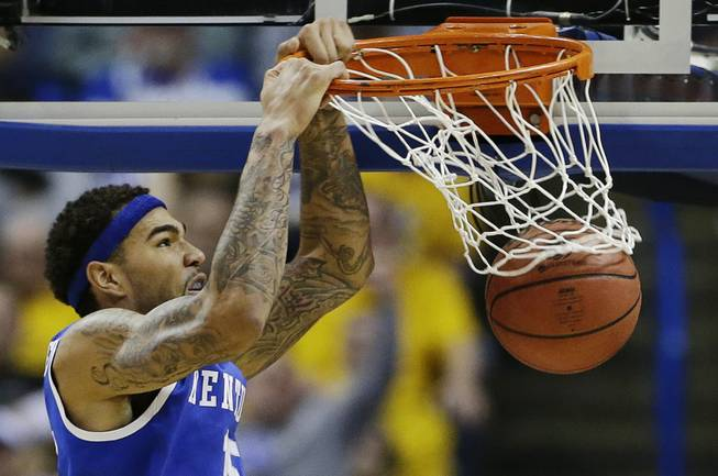 Kentucky forward Willie Cauley-Stein (15) dunks against Wichita State during the second half of a third-round game of the NCAA college basketball tournament Sunday, March 23, 2014, in St. Louis.