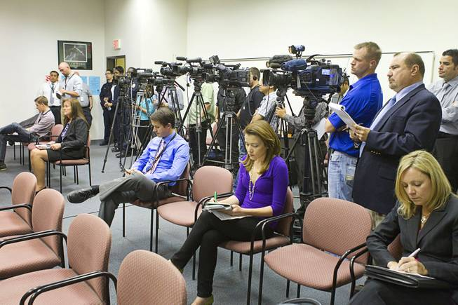 Reporters and photographers cover a news conference at Clark County School District Police Headquarters in Henderson Monday, March 24, 2014. Officials addressed questions about an investigation into the possible misuse of funds by employees in the Adult English Language Acquisition Services (AELAS) department.